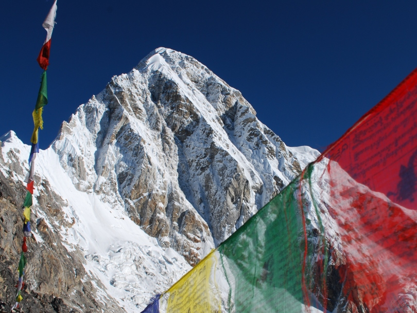 Nepalese mountain view and prayer flags